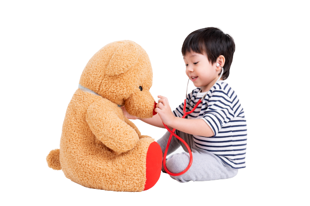 little-boy-playing-doctor-with-teddy-bear-removebg-preview